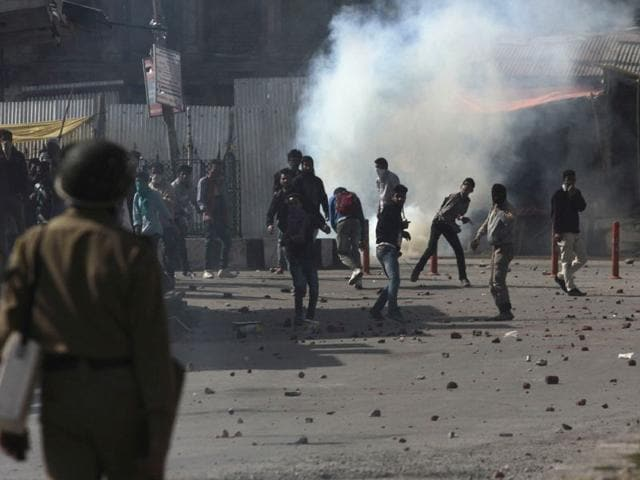 Protesters-throwing-stones-at--policemen-during-a-protest-against-Tral-killing-and--Separatist-leader-Masarat-Alam-s-arrest-in-Srinagar-Waseem-Andrabi-HT