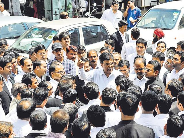 Lawyers-gather-near-the-spot-where-Rajeev-Sharma-was-found-dead-inside-the-Tis-Hazari-court-complex-on-Friday-Mohd-Zakir-HT-Photo