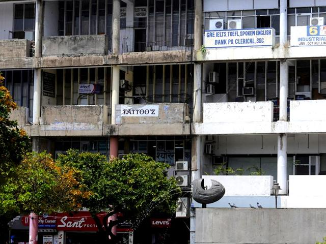 A-building-with-one-half-of-its-concrete-blackened-and-the-rest-painted-Gurpreet-Singh-HT-Photo
