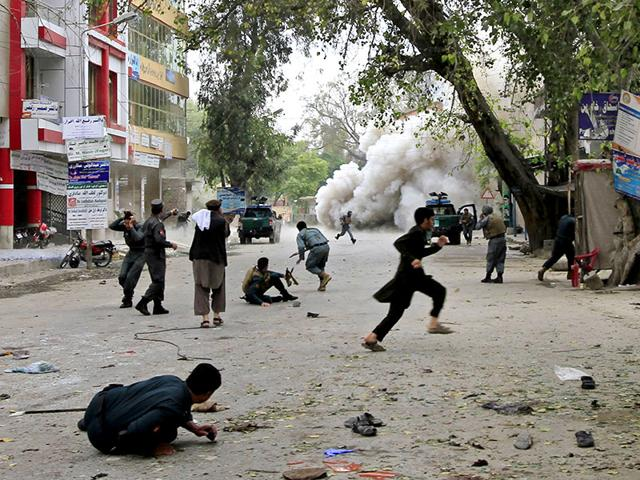 People-run-for-cover-after-an-explosion-in-Jalalabad-A-suicide-bomb-blast-in-the-city-killed-33-people-and-injured-more-than-100-outside-a-bank-where-government-workers-collect-salaries-the-city-s-police-chief-said-Reuters