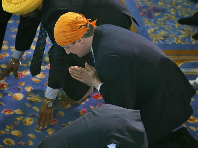 The-Prime-Minister-and-his-wife-joined-some-3-000-worshippers-for-the-spring-Festival-of-Vaisakhi-as-Cameron-continues-campaigning-ahead-of-the-upcoming-May-7-General-Election-AP