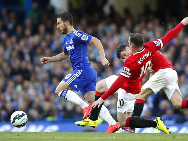 Chelsea-midfielder-Eden-Hazard-L-skips-past-a-challenge-from-Manchester-United-s-Wayne-Rooney-R-during-the-English-Premier-League-football-match-between-Chelsea-and-Manchester-United-at-Stamford-Bridge-in-London-on-April-18-2015-AFP-Photo
