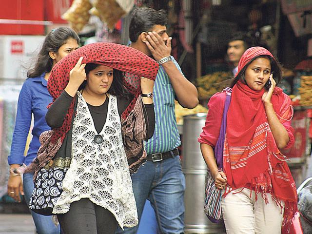Rise-in-day-temperature-compelled-Bhopal-residents-to-protect-them-from-the-scorching-sun-on-Sunday-Bidesh-Manna-HT-photo