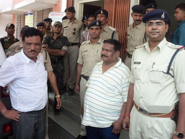 Balagaht-RTO-RD-Das-left-in-while-shirt-and-RTO-clerk-RP-Gaud-in-T-Shirt-in-police-custody-in-Balaghat-on-Sunday-HT-photo