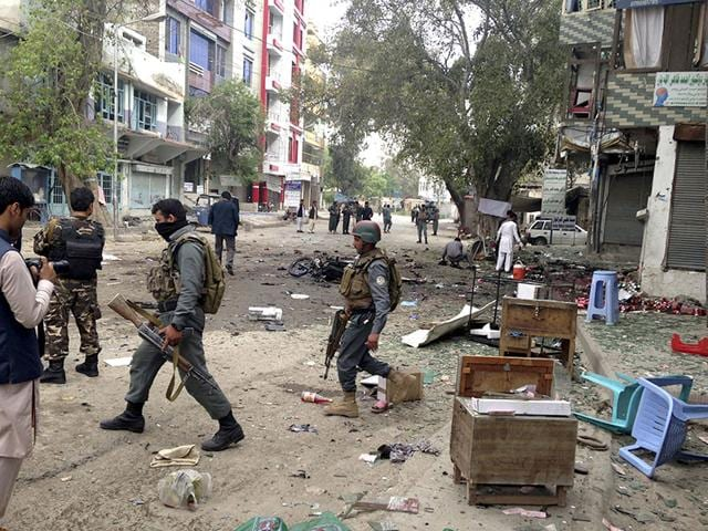 Afghan-security-forces-members-inspect-the-site-of-a-suicide-attack-near-a-new-Kabul-Bank-in-Jalalabad-east-of-Kabul-Afghanistan-AP-Photo