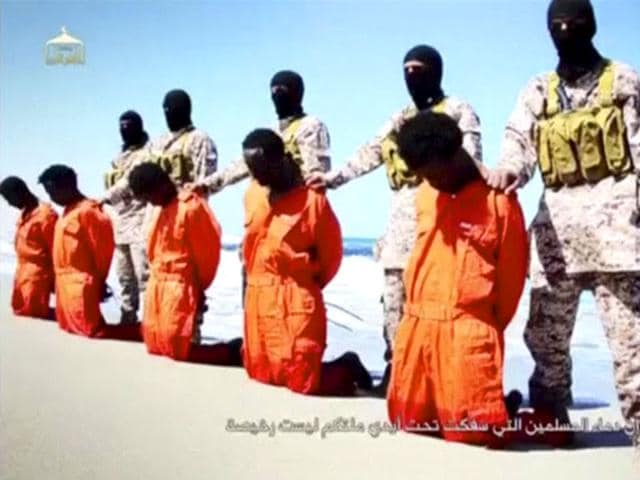 Islamic-State-militants-stand-behind-what-are-said-to-be-Ethiopian-Christians-along-a-beach-in-Wilayat-Barqa-in-this-still-image-from-an-undated-video-made-available-on-a-social-media-website-Reuters