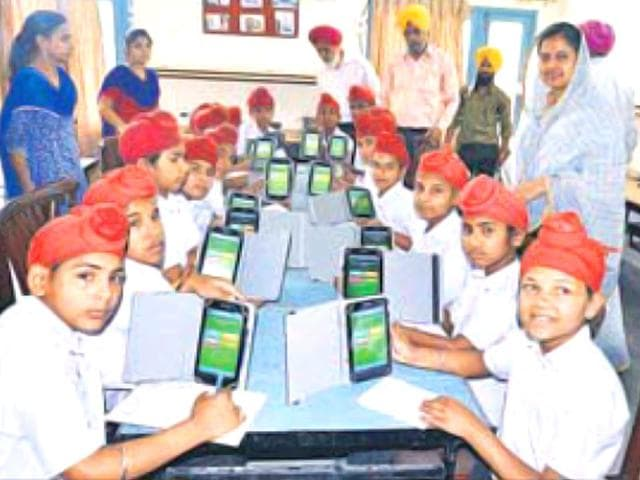 SGPC-member-Kiranjot-Kaur-standing-extreme-right-looks-on-after-distributing-tablets-at-Chief-Khalsa-Diwan-s-central-orphanage-in-Amritsar-Sameer-Sehgal-HT-Photo