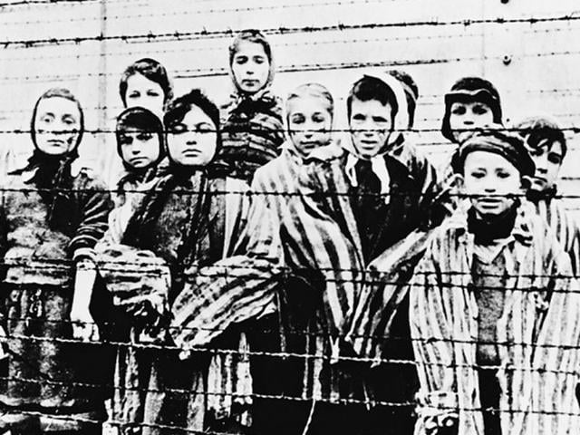 A-group-of-children-at-the-Auschwitz-Nazi-concentration-camp-in-a-picture-taken-after-the-liberation-by-the-Soviet-army-in-January-1945-AP-File-Photo