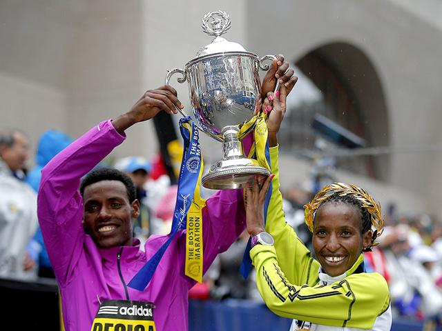 Men-s-division-winner-Lelisa-Desisa-of-Ethiopia-and-women-s-division-winner-Caroline-Rotich-of-Kenya-pose-with-the-trophy-at-the-finish-line-of-the-119th-Boston-Marathon-in-Boston-Massachusetts-on-Monday-Reuters-Photo