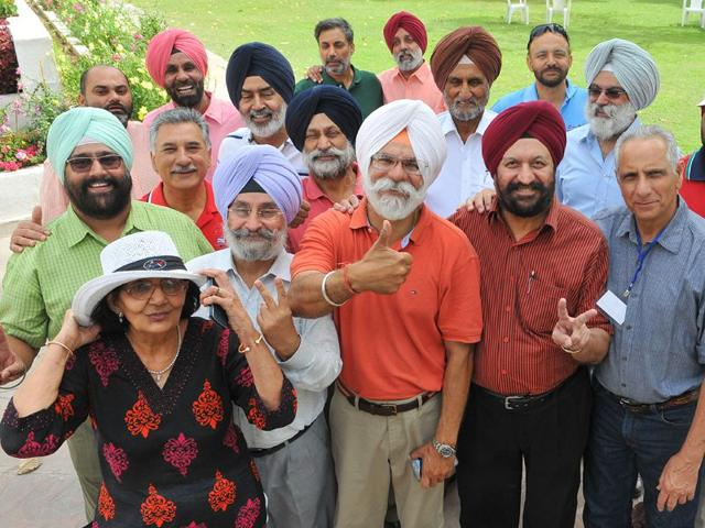 Newly-elected-president-Birinder-Singh-Gill-orange-t-shirt-along-with-other-members-at-Chandigarh-Golf-Club-Keshav-Singh-HT