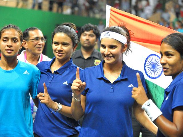 India-s-Sania-Mirza-and-Prarthana-G-Thombare-along-with-team-members-celebrate-after-winning-the-match-against-Philippines-s-players-Katharina-Lehnert-and-Anna-Clarice-Patrimonio-during-the-women-s-doubles-in-the-Fed-Cup-Oceana-Group-II-Tennis-Championship-final-at-the-Fateh-Maidan-Tennis-complex-in-Hyderabad-AFP-PHOTO