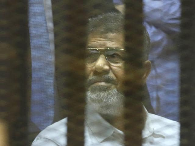 Egypt-s-ousted-Islamist-President-Mohammed-Morsi-sits-in-a-soundproof-glass-cage-inside-a-makeshift-courtroom-at-Egypt-s-national-police-academy-in-Cairo-Egypt-AP-Photo