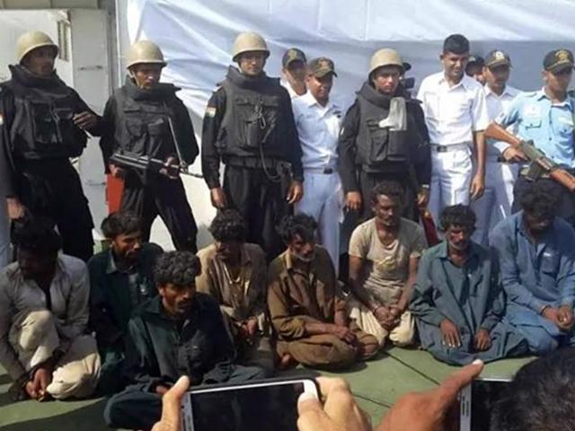 The-Indian-Navy-and-Coast-Guard-intercepted-a-boat-with-eight-suspected-Pakistani-smugglers-and-more-than-200-packets-of-heroin-with-a-street-value-of-Rs-600-crore-HT-Photo