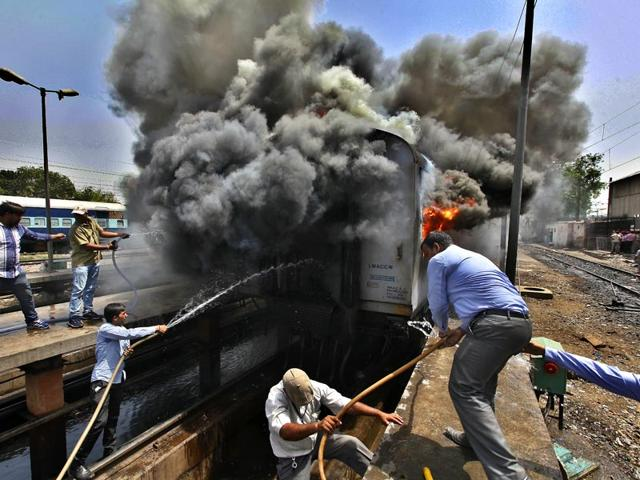As-many-as-six-empty-coaches-of-two-Rajdhani-trains-were-gutted-in-the-fire-Tuesday-afternoon-at-New-Delhi-railway-station-s-maintenance-yard-Raj-K-Raj-HT-Photo