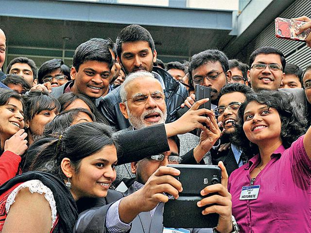 Prime-Minister-Narendra-Modi-takes-a-selfie-with-Indian-students-during-his-visit-to-Airbus-facility-in-Toulouse-France-Photo-PTI