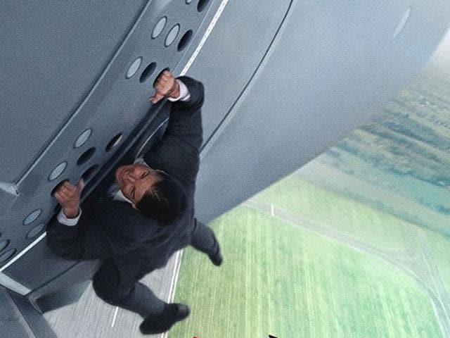 Tom-Crusie-hangs-on-the-side-of-a-plane-5-000-feet-in-the-air-in-Mission-Impossible-5