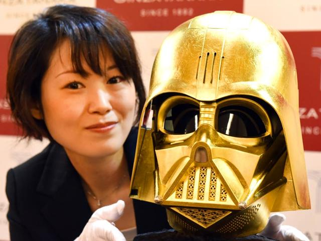 A-sales-clerk-introduces-a-Darth-Vader-mask-gilded-with-gold-leaf-produced-by-Japan-s-jeweler-Ginza-Tanaka-in-Tokyo-on-April-22-2015-AFP-PHOTO
