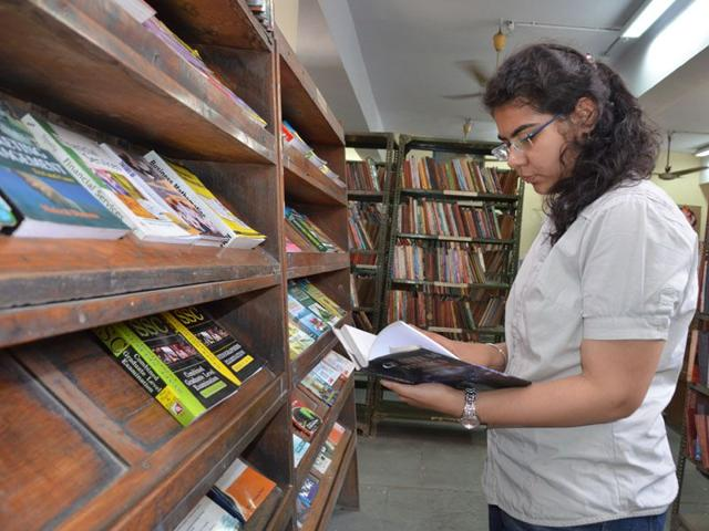 A-girl-going-through-books-in-Ambala-central-library-HT-Photo