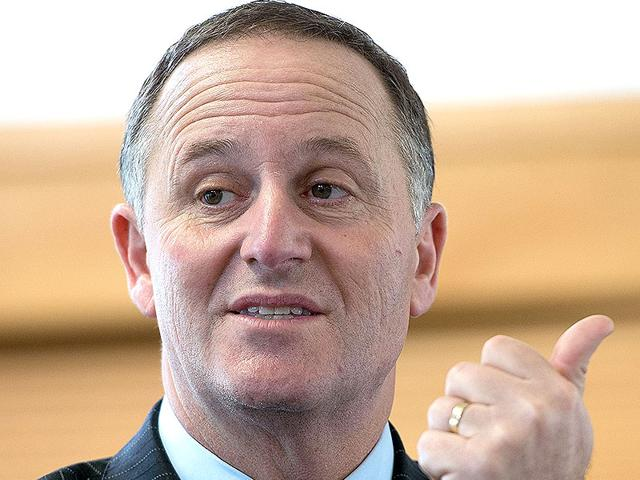 New-Zealand-Prime-Minister-John-Key-speaking-to-students-in-Masterton-during-an-election-campaign-Key-recently-publicly-apologised-to-a-waitress-who-labelled-him-a-schoolyard-bully-for-repeatedly-pulling-her-ponytail-AFP-PHOTO