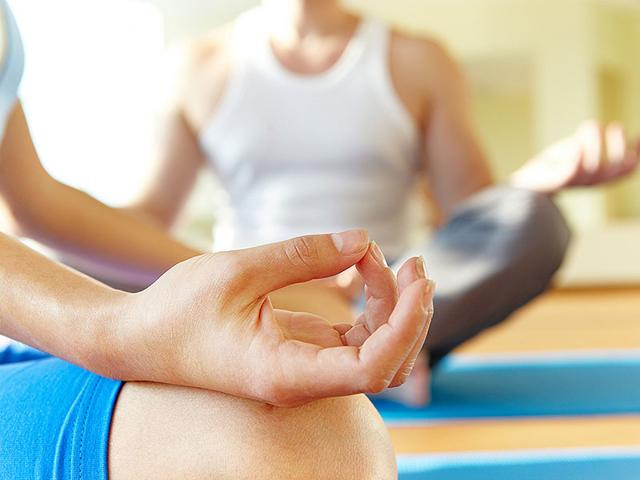 A-new-study-says-Bikram-yoga-sessions-should-be-30-minutes-shorter-and-offer-more-water-breaks-to-keep-participants-safe-from-heat-related-illness-Shutterstock
