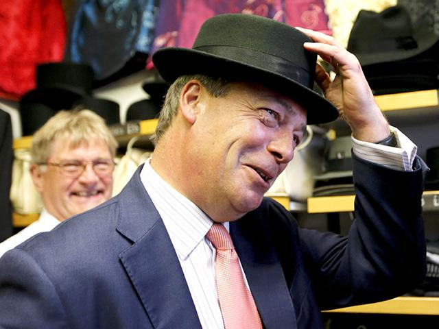 The-leader-of-the-United-Kingdom-Independence-Party-UKIP-Nigel-Farage-tries-on-a-hat-during-a-visit-to-a-small-business-that-has-expressed-its-support-for-the-party-in-Canterbury-southern-England-REUTERS