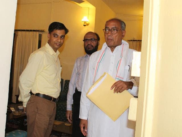 AICC-general-secretary-Digvijaya-Singh-right-along-with-AIG-special-task-force-Ashish-Khare-left-at-his-official-residence-in-Bhopal-on-Thursday-HT-photo