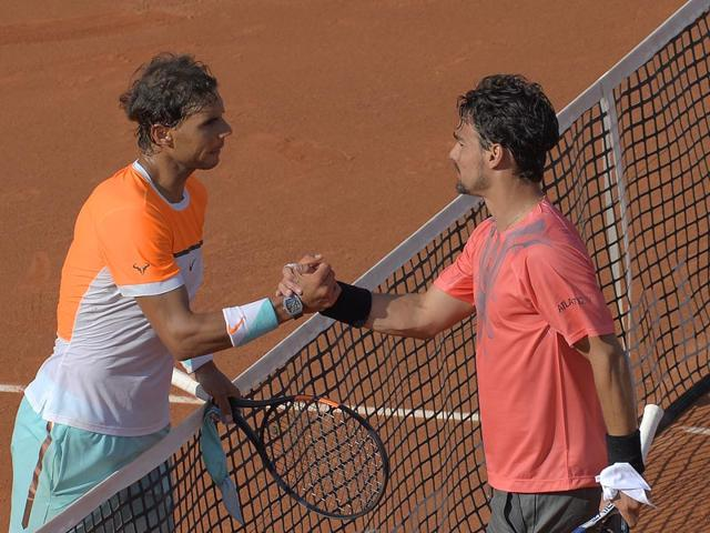 Rafael-Nadal-shakes-hands-with-Fabio-Fognini-after-losing-to-him-in-the-third-round-of-Barcelona-Open-on-Thursday-AP-Photo