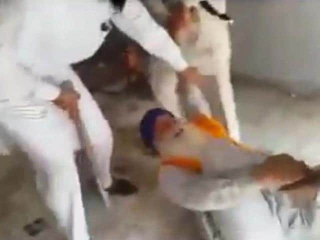 A-video-showing-a-group-of-15-miscreants-thrashing-three-gurdwara-priests-has-gone-viral-on-the-social-networking-sites