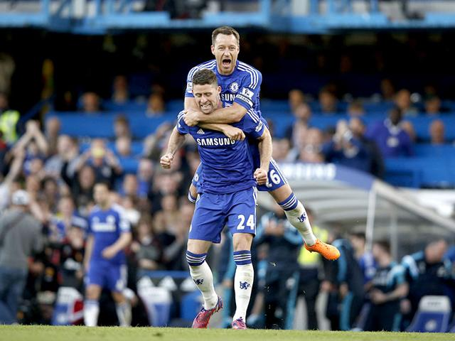 Chelsea-s-English-defender-John-Terry-and-Chelsea-s-English-defender-Gary-Cahill-celebrate-their-1-0-victory-after-the-final-whistle-of-the-English-Premier-League-football-match-between-Chelsea-and-Manchester-United-at-Stamford-Bridge-in-London-AFP-PHOTO
