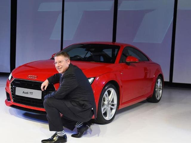 Audi-India-Head-Joe-King-poses-for-a-photograph-alongside-the-newly-launched-Audi-TT-sports-car-at-a-promotional-event-in-New-Delhi--Photo-AFP