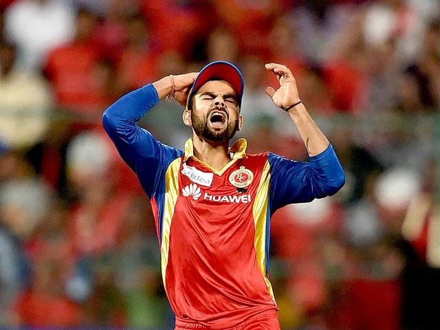 BCCI-president-Jagmohan-Dalmiya-has-said-India-s-new-Test-captain-Virat-Kohli-will-be-on-notice-over-his-behaviour-In-the-picture-above-Kohli-and-Yuzvendra-Chahal-of-Royal-Challengers-Bangalore-celebrate-after-taking-the-wicket-of-Rajasthan-Royals-skipper-Shane-Watson-during-an-Indian-Premier-League-match-in-Ahmedabad-on-Friday-Kunal-Patil-HT-Photo