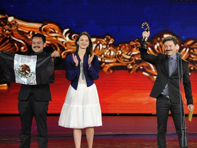 Mexican-director-Bernardo-Arellano-R-raises-a-Tiantan-Award-trophy-as-he-celebrates-with-cast-members-on-the-stage-after-winning-the-best-film-award-at-the-closing-ceremony-of-the-5th-Beijing-International-Film-Festival-in-Beijing-April-23-2015-Mexican-director-Arellano-s-drama-about-an-elderly-couple-facing-economic-hardship-has-scooped-the-best-film-award-at-the-fifth-Beijing-International-Film-Festival-Comienzo-del-Tiempo-or-The-Beginning-of-Time-tells-the-story-of-Antonio-and-Bertha-who-fall-on-hard-times-when-social-security-pensions-are-stopped-because-of-a-national-financial-crisis-Reuters