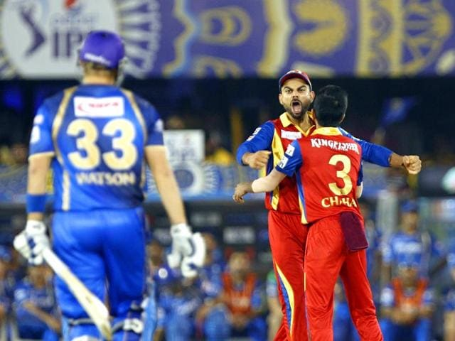 Virat-Kohli-and-Mitchell-Starc-of-Royal-Challengers-Bangalore-celebrate-the-wicket-of-a-Rajasthan-Royals-player-during-an-Indian-Premier-League-IPL-season-8-match-between-the-two-teams-at-Sardar-Patel-Stadium-in-Ahmedabad-Kunal-Patil-HT-Photo