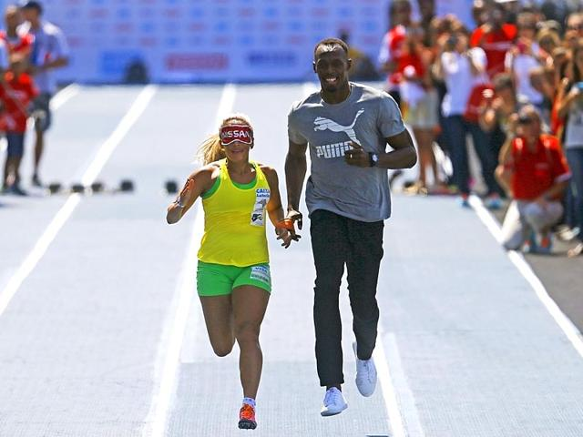 Jamaican-Olympic-gold-medallist-Usain-Bolt-guides-Brazilian-Paralympic-athlete-Terezinha-Guilhermina-before-the-Mano-a-Mano-challenge-100-metre-race-in-Rio-de-Janeiro-Reuters-Photo