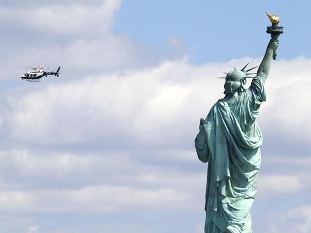 A-New-York-Police-helicopter-circles-over--Liberty-Island-where-the-Statue-of-Liberty-was-evacuated-with-officers-responding-to-a-report-of-a-suspicious-package-seen-from-Jersey-City-N-J-Friday-April-24-2015-AP-Photo