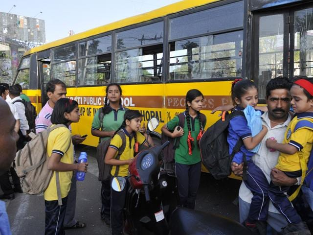 Parents-take-away-their-children-after-a-school-bus-was-hit-by-a-speeding-tanker-at-Board-Office-Square-in-MP-Nagar-in-Bhopal-Praveen-Bajpai-HT-photo