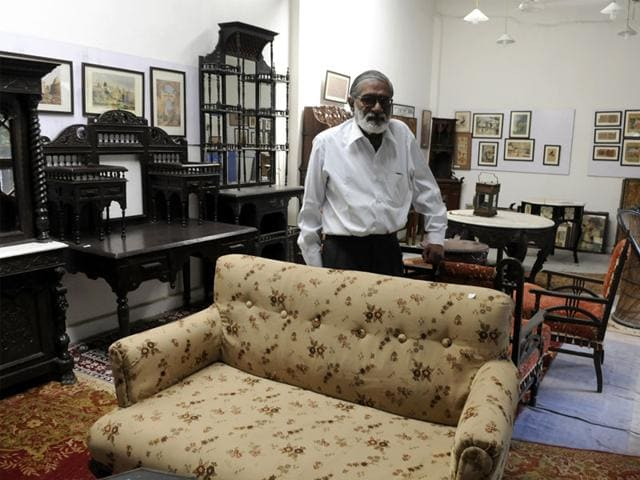Rajendra-Singh-shows-an-antique-furniture-at-his-studio-HT-photo
