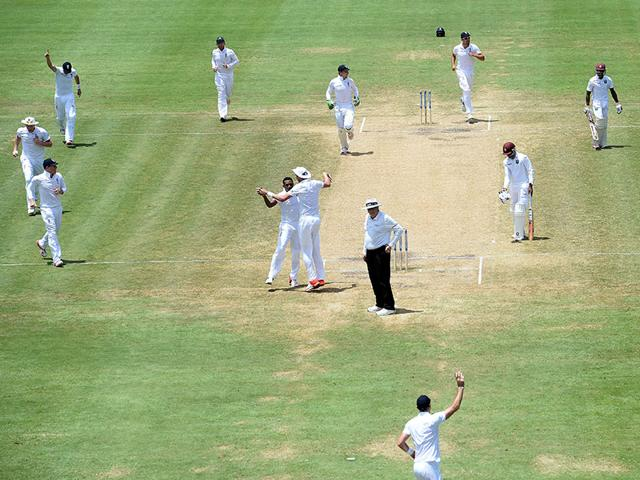 James-Anderson-bottom-celebrates-after-taking-a-catch-off-bowler-Chris-Jordan-to-dismiss-West-Indies-batsman-Jermaine-Blackwood-during-the-final-day-of-the-second-Test-match-between-the-West-Indies-and-England-at-the-Grenada-National-Cricket-Stadium-in-Saint-George-s-on-April-25-2015-AFP-Photo