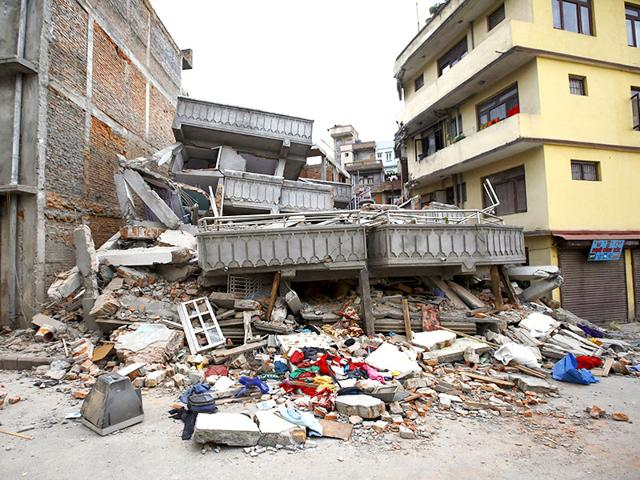 In-this-photo-released-by-China-s-Xinhua-News-Agency-a-collapsed-building-is-seen-in-Nepal-s-capital-Kathmandu-AP-Photo