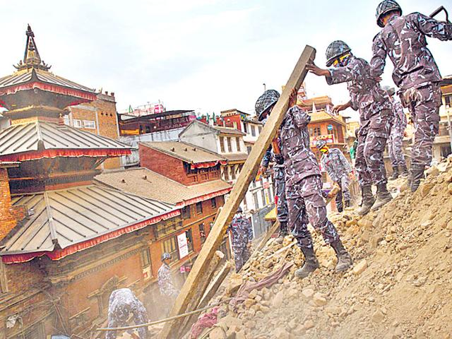 Policemen-clear-debris-at-the-Durbar-Square-in-Kathmandu-on-Sunday-Reuters