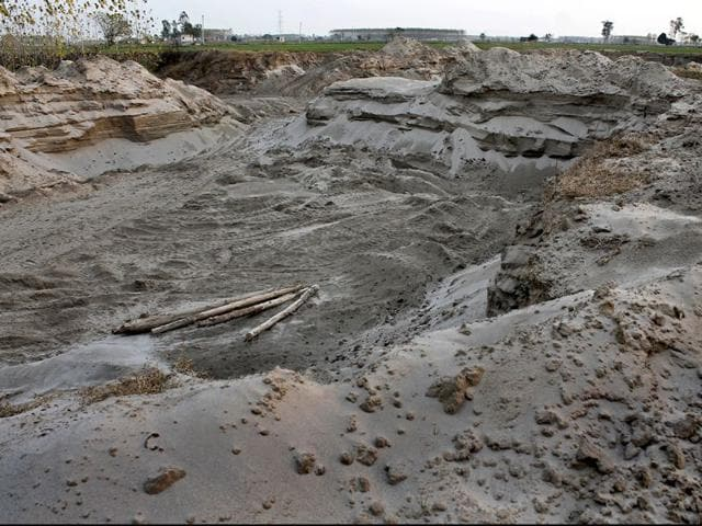 This-agricultural-land-owned-by-the-Jodhwal-village-panchayat-near-Macchiwara-in-Ludhiana-district-has-been-plundered-by-the-sand-mining-mafia-over-the-years-Gurminder-Singh-HT-file-Photo