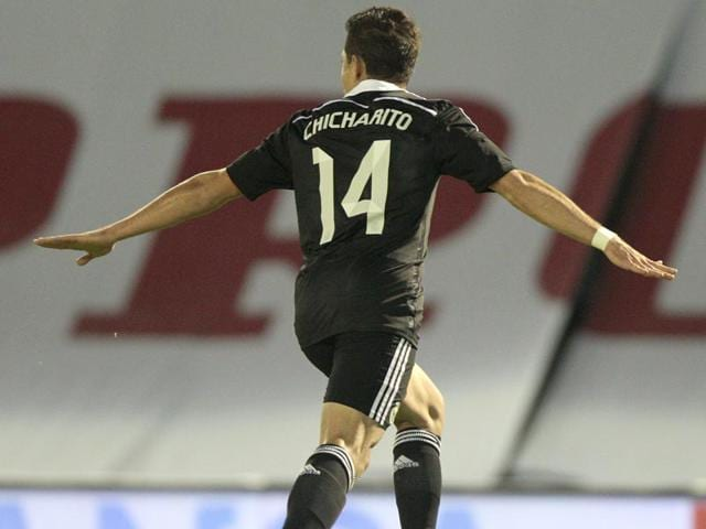 9fc00e686 Real-Madrid-s-Chicharito-celebrates-after-scoring-his-team-s-fourth-goal -during-a-Spanish-La-Liga-soccer-match-between-RC-Celta-and-Real-Madrid-at-the-Bala-  ...
