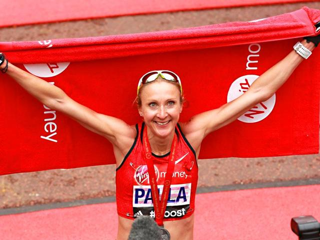 British-runner-Paula-Radcliffe-celebrates-after-crossing-the-finish-line-in-her-last-ever-race-during-the-2015-London-Marathon-in-central-London-on-April-26-2015-AFP-Photo