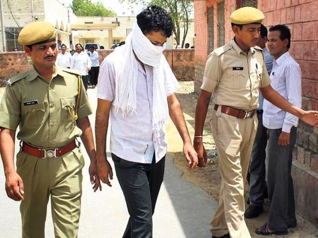 Pradeep-Balach-in-police-custody-HT-Photo