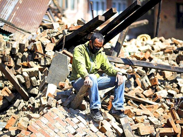 A-man-sits-on-the-rubble-of-his-damaged-house-in-Bhaktapur-Nepal-Reuters-Photo