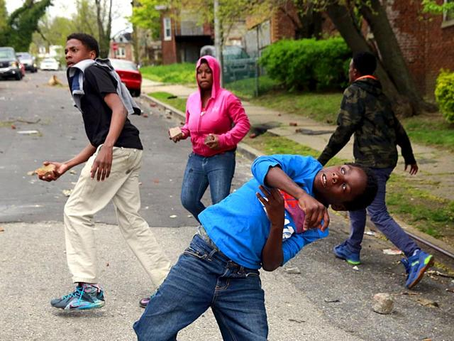 Demonstrators-throw-rocks-at-Baltimore-police-during-clashes-in-Baltimore-Reuters