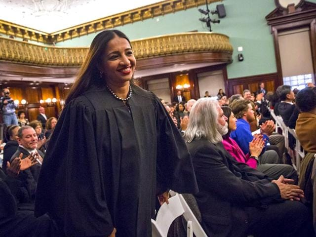 Newly-appointed-city-judge-Raja-Rajeswari-from-Chennai-India-rises-to-take-her-place-for-a-Judicial-Swearing-In-Ceremony-at-New-York-City-Hall-in-New-York-April-27-2015-Reuters-Photo