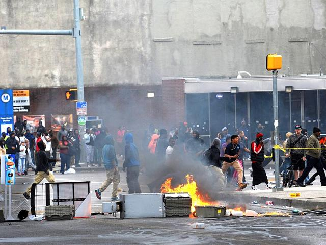 A-fire-burns-in-the-street-Monday-April-27-2015-during-unrest-following-the-funeral-of-Freddie-Gray-in-Baltimore-AP-Photo