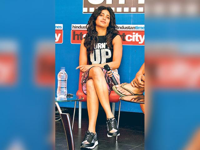 Shruti-Haasan-is-one-of-the-several-B-Town-celebs-who-have-been-spotted-pairing-formal-wear-with-sneakers-for-stylish-public-appearances-and-red-carpet-dos-HT-Photo