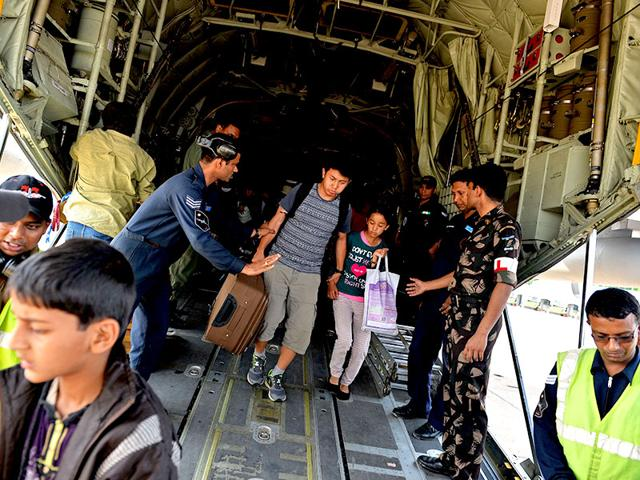 Indian-Air-Force-IAF-personnel-assist-Indian-people-as-they-disembark-from-an-IAF-aircraft-on-arrival-from-Nepal-at-Palam-Air-Force-Station-near-New-Delhi-AFP-Photo